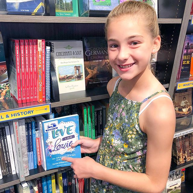 Evi, co-author of Love Like Louie, checking out her book on @josephbethcincy shelves 😍 We are so proud of her 💙 #lovelikelouie #cincy