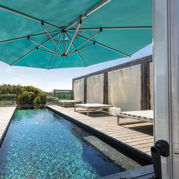 Frame - -Heavy duty design (approx. 37kg weight) maximises strength and wind resistance while still maintaining a contemporary design aesthetic.-Well suited to exposed areas such as large pools, high decks and coastal locations etc.-Frames are made of Marine Grade Anodised Aluminium.-3 year warranty against mechanical defects.