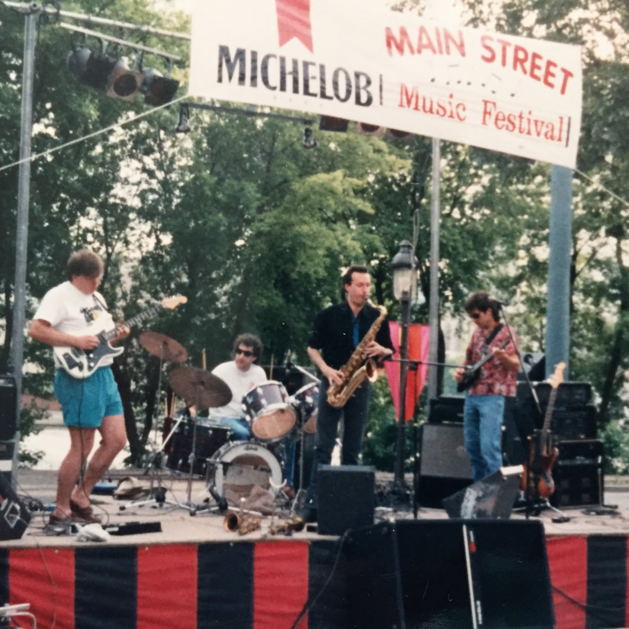 Early version of BFG: Mike Bruns, Rik Sferra, Hall Sanders, Todd Larson. Performing at the Main Street Music Festival, Minneapolis. Prior to 1993.
