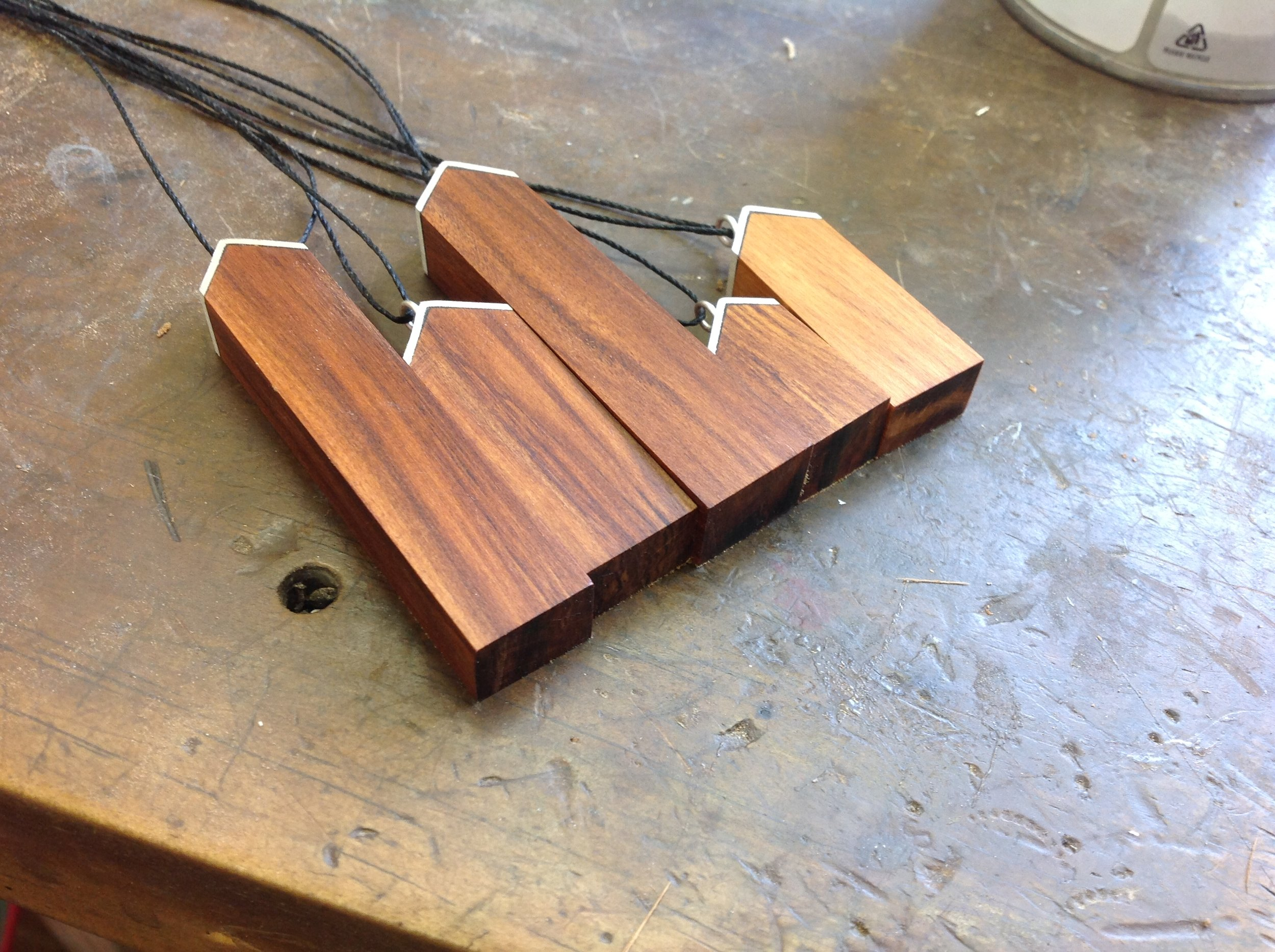 - Recycled wood House Pendants for Rekindle    Sterling Silver & Rimu