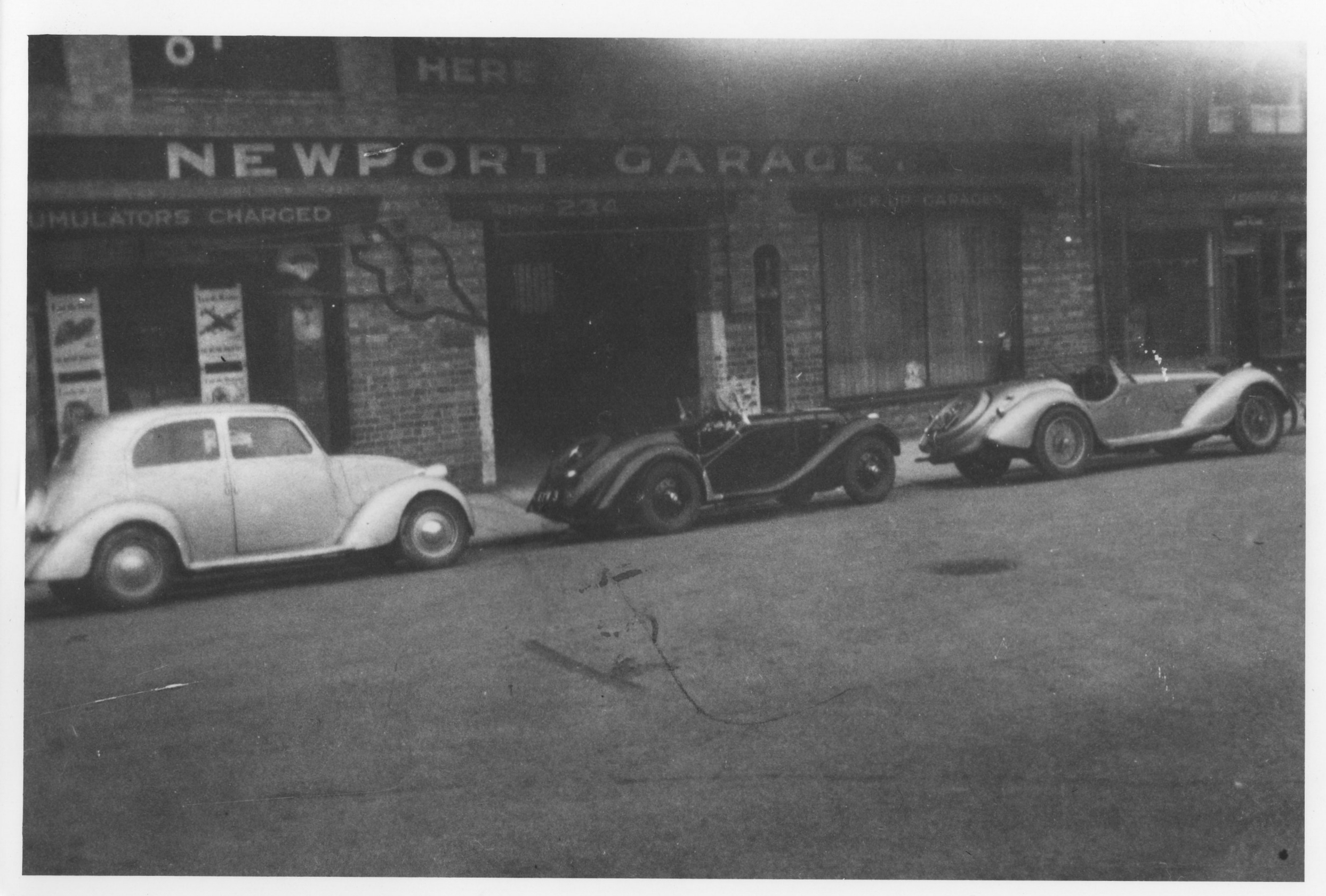 """Fiat """"Topolino"""", 328 BMW (badged Frazer Nash) and the fabulous Alfa 2.9 (all three cars Crook) at the Newport Garage in Lincoln"""