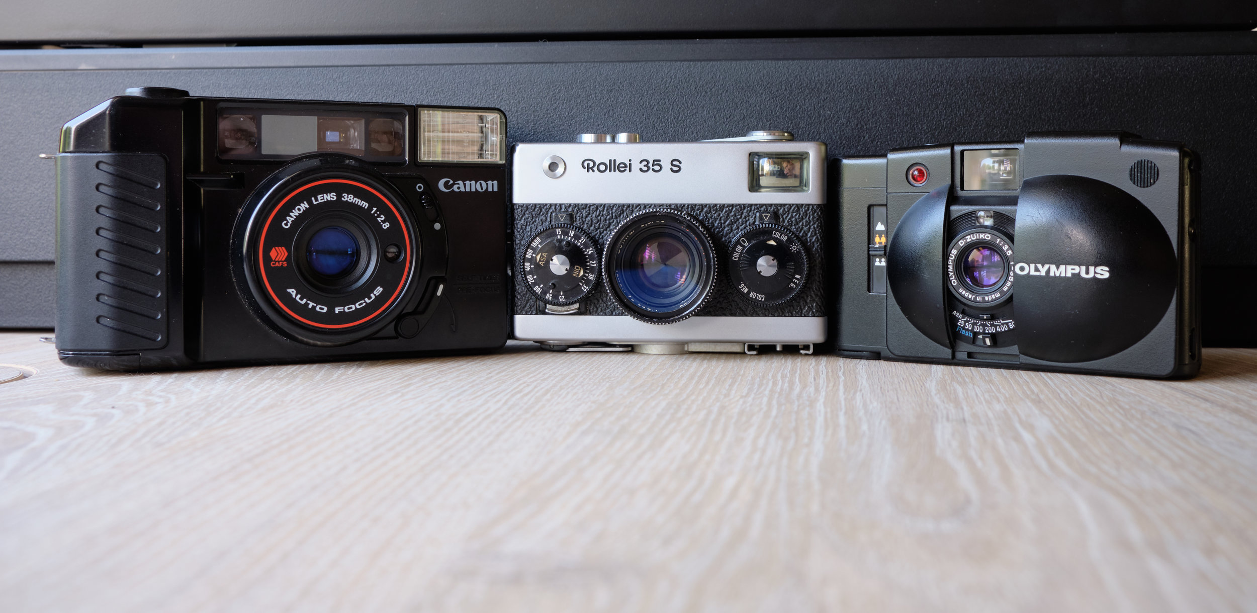 Canon Sure Shot, Rollei 35s, and Olympus XA2.