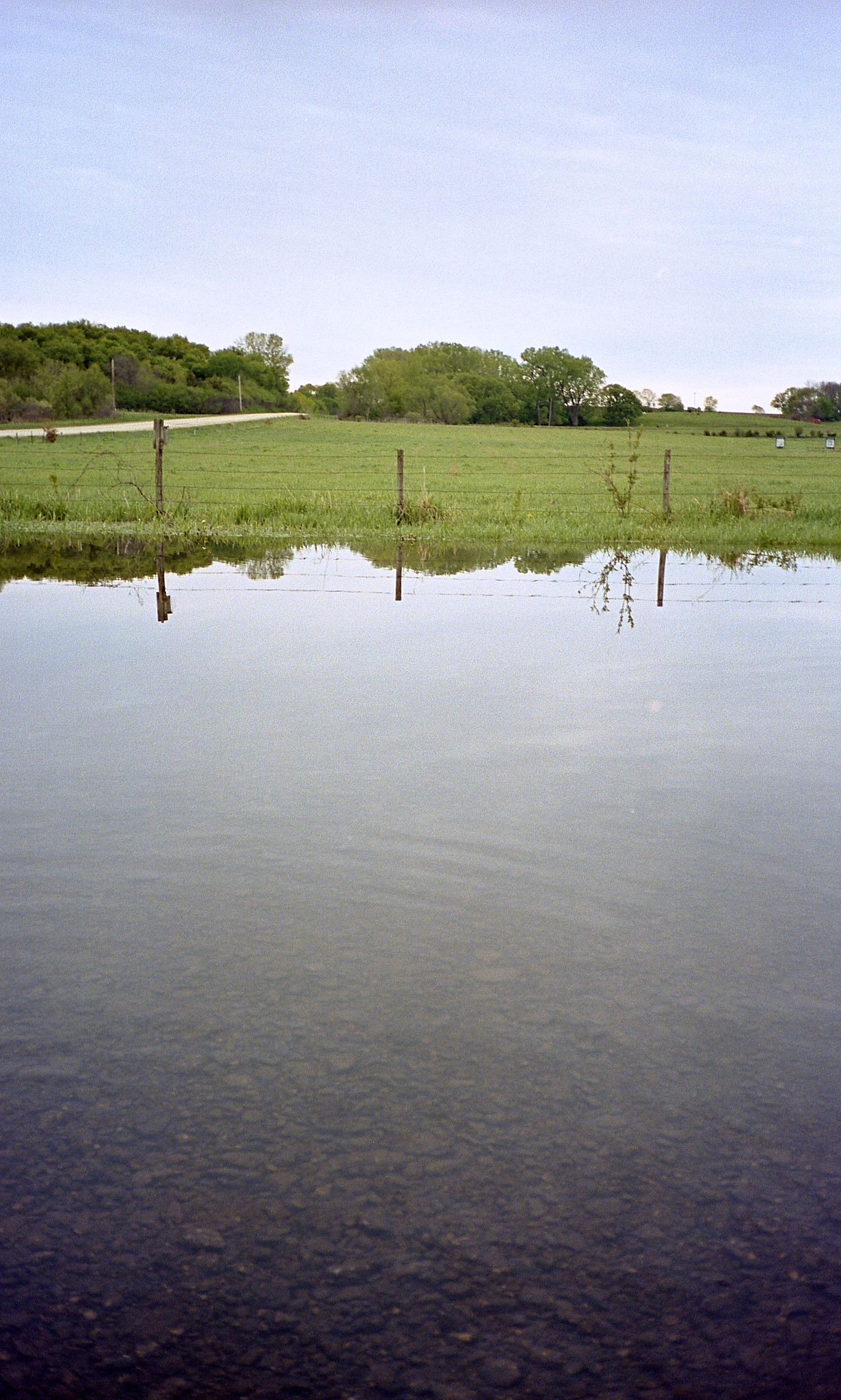 Kodak Portra 400, parking lot of the place above after a lot of rain.