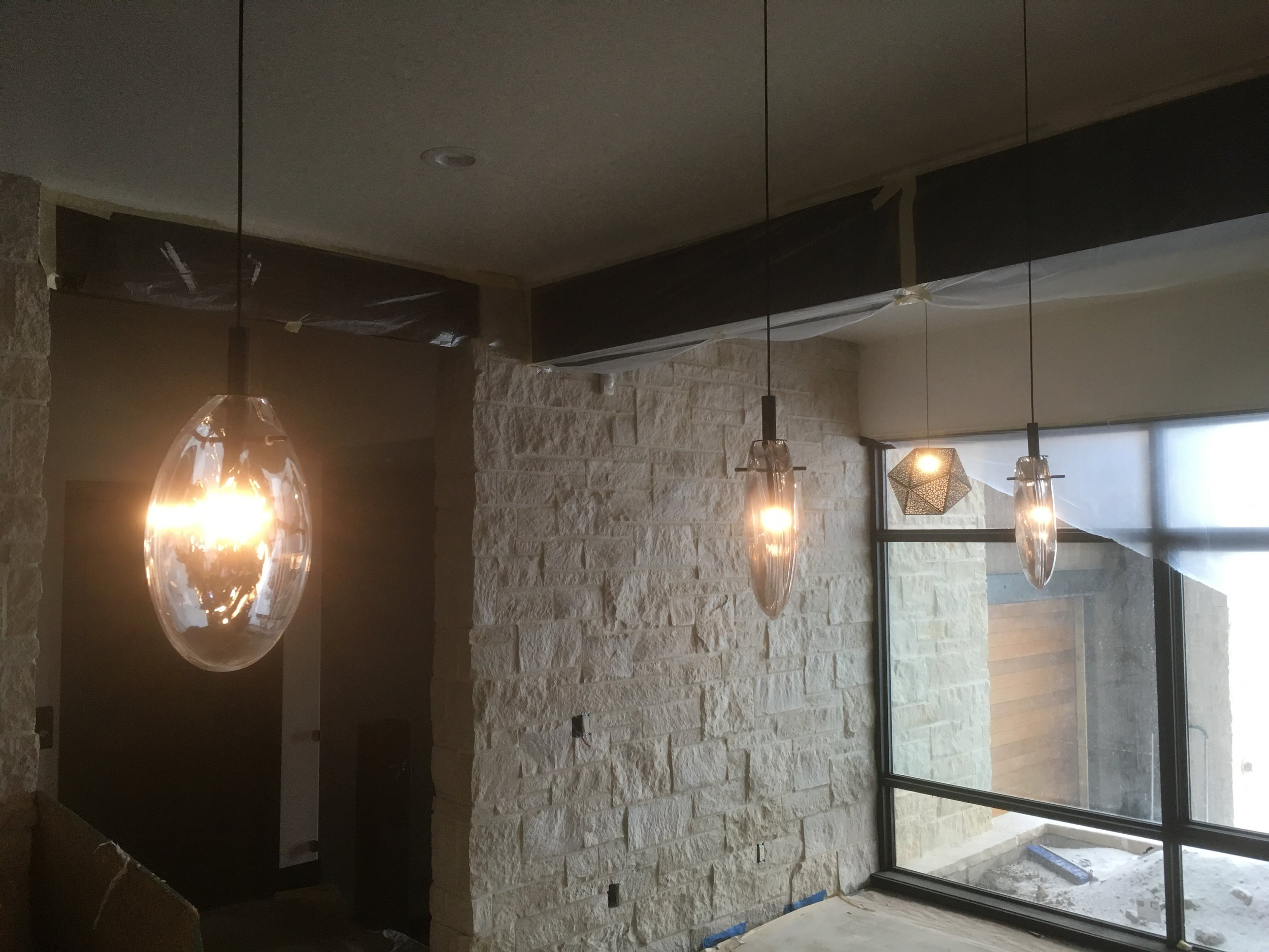 Lower-level bar pendants with the 'card table' light in the background