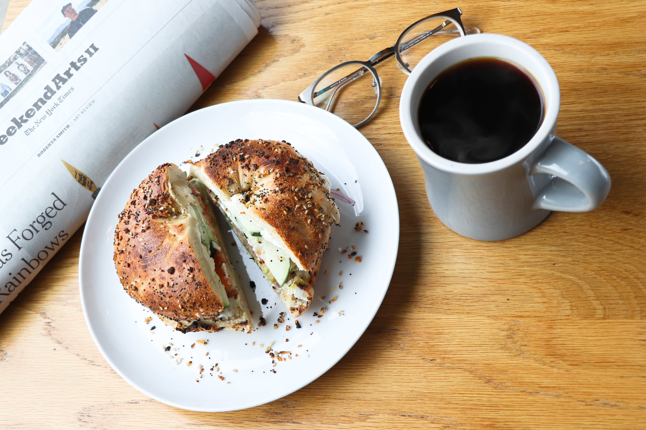 Bagel sandwich with black coffee