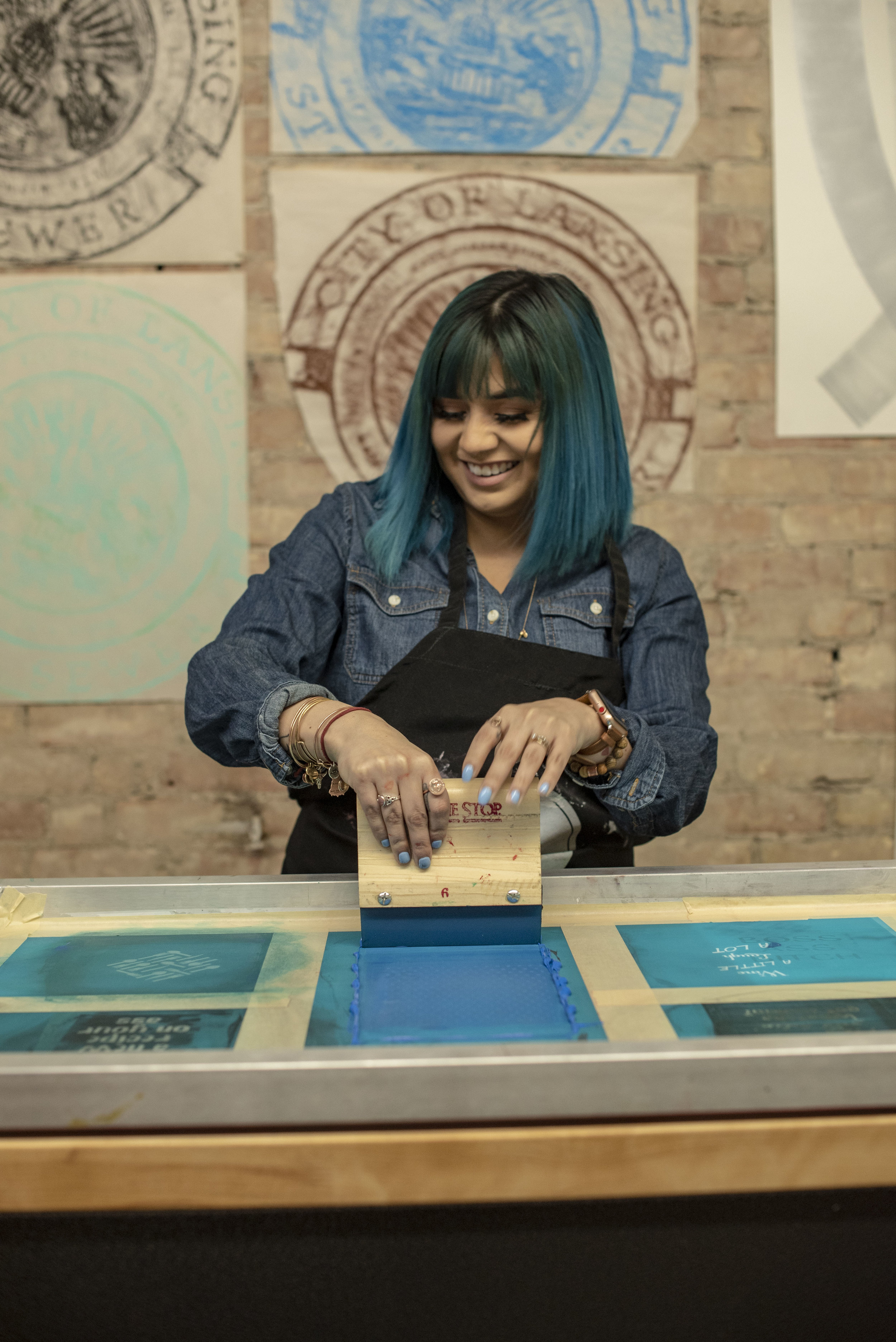 Attendee learning how to screen print during our Ladies Night workshop in Reo Town, February 2019.