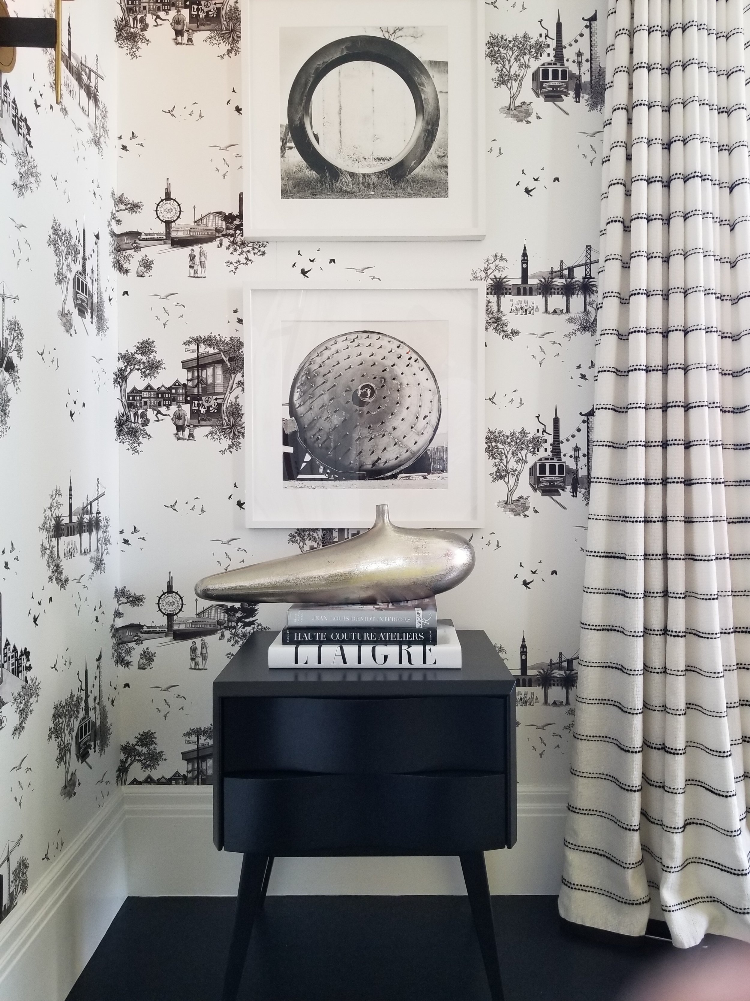 The wallpaper is a whimsical take on toile wallpaper.