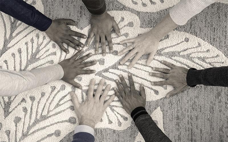global collaboration hands on botanical leaf rug