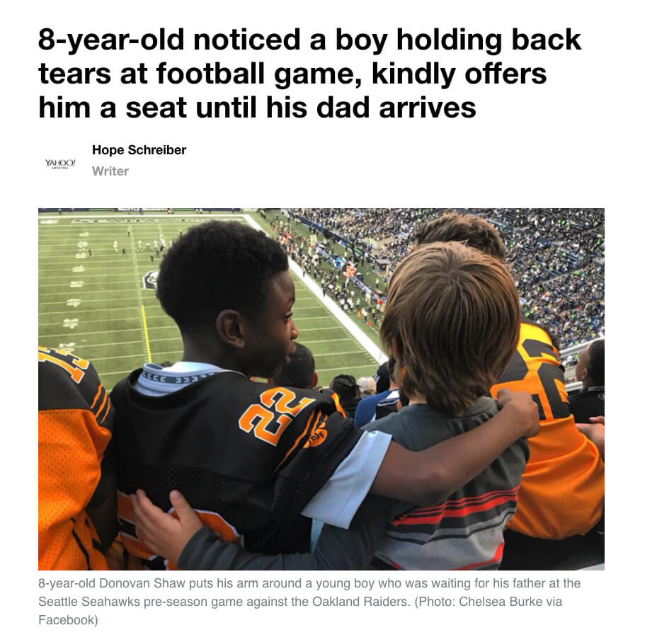 Eight Year Old Offers Seat at Football Game