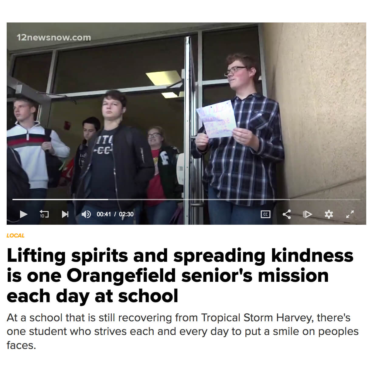 Student holds door in Orangefield