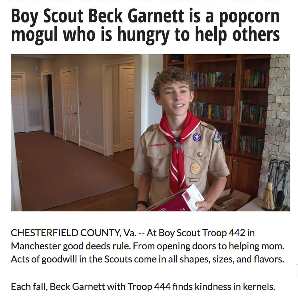 Boy Scout Donates Popcorn Proceeds.jpg