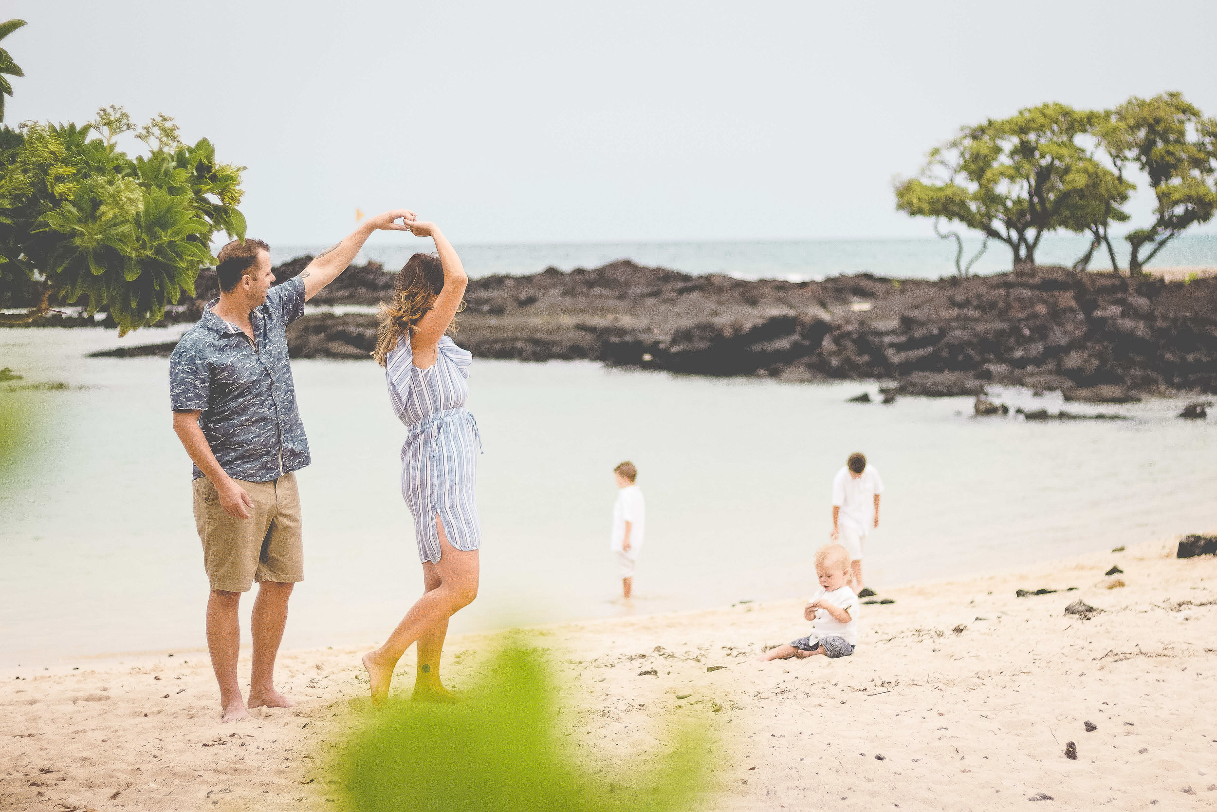 Family beach session photography in Kona at beautiful White sand location in big island hawaii photographer.jpg