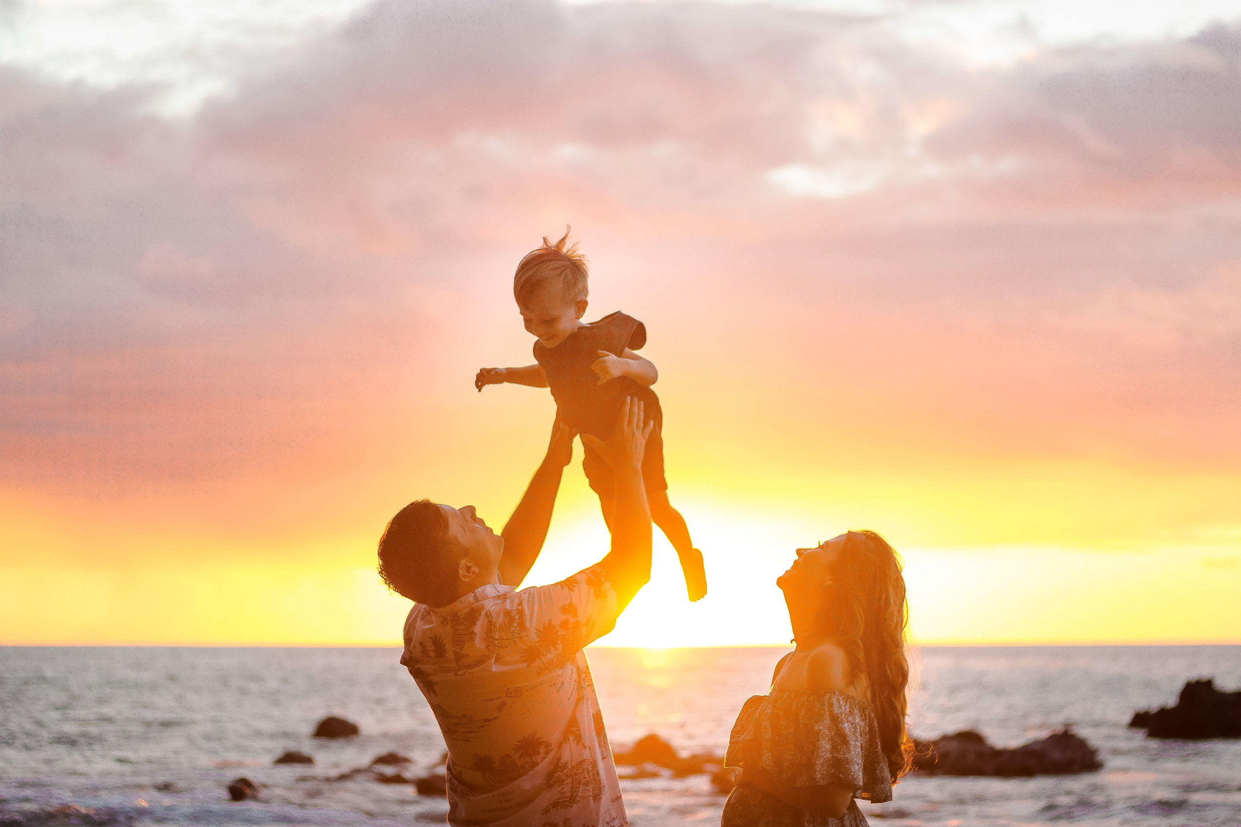 sunset family beach with toddler in kona hawaii big island photographer.jpg