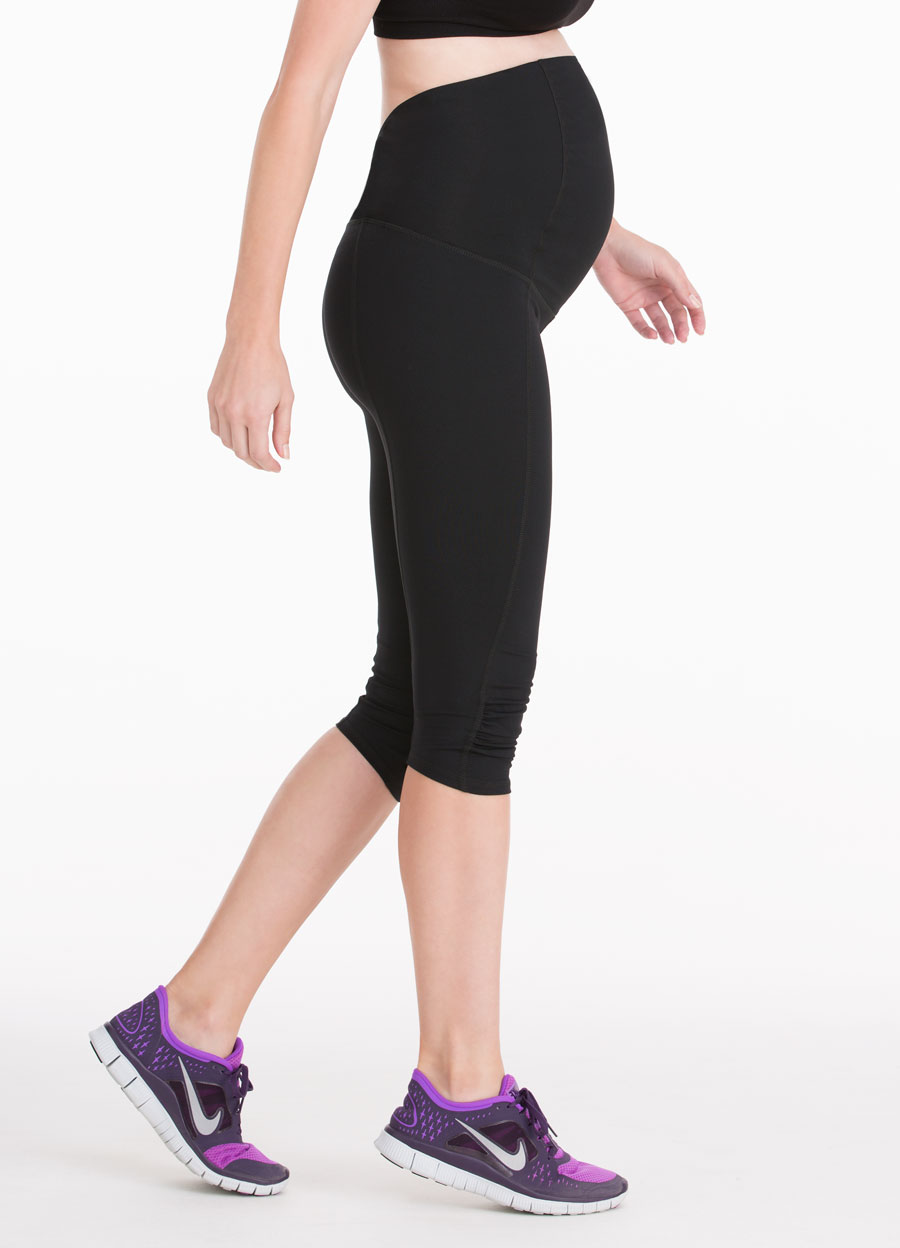 Active Knee Pant ft. Crossover Panel® - • Crossover Panel® provides gentle support to the lower back as your belly grows.•Contoured panel accommodates a growing belly.•Four-way stretch fabric allows full range of motion.• Moisture-wicking and antimicrobial.• Flatlock stitching minimizes chafe.•Wear up or folded down for versatile comfort before and after baby.