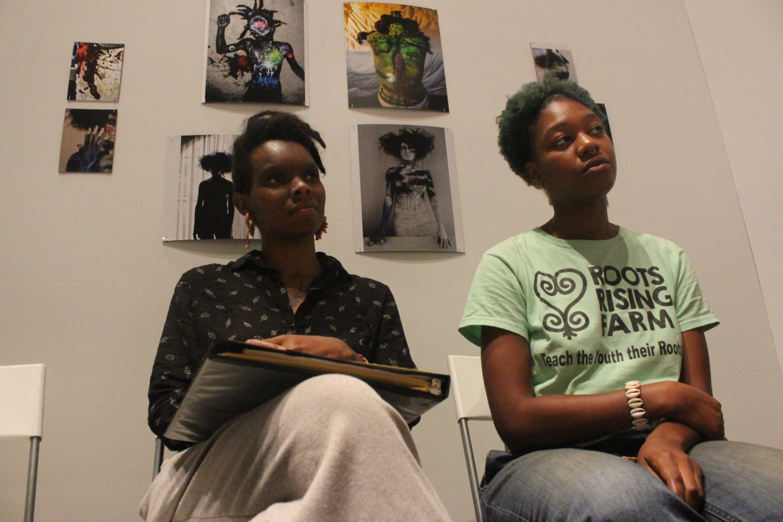 "Co-founders Blache and Rose teaching ""Time Travel through Blood Memory"" at Time Camp 001, a Black Quantum Futurism exhibition."