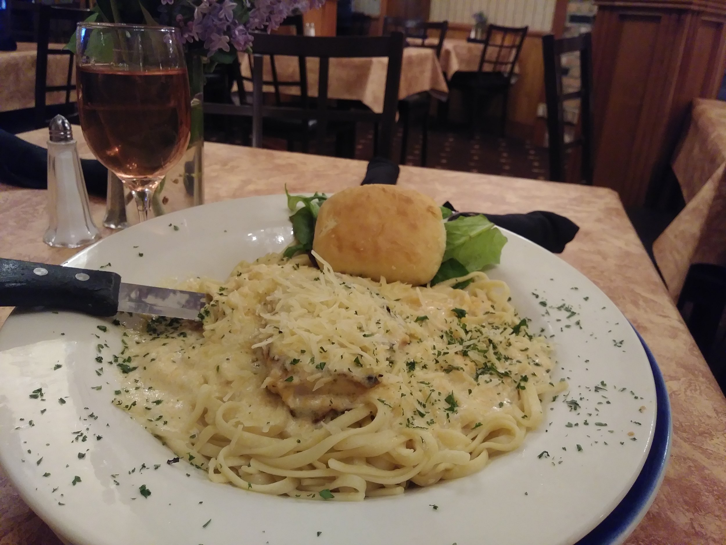 Chicken alfredo - A 6 ounce broiled chicken breast smothered in The Thayer's parmesan sauce, served over linguini$12.99