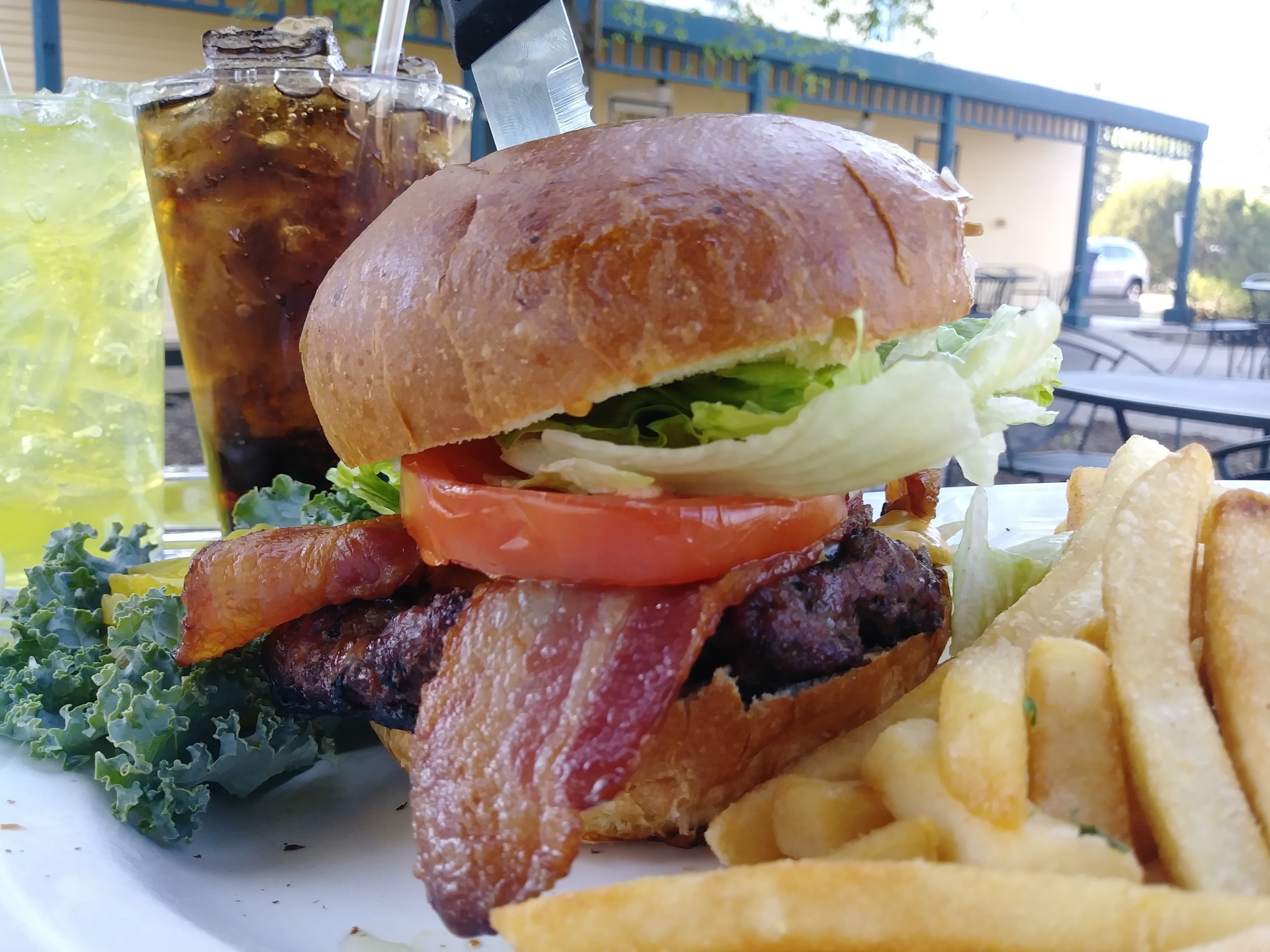 Thayer burger deluxe - A bacon cheese burger topped with mayo, lettuce, tomato, & raw onions $11.99