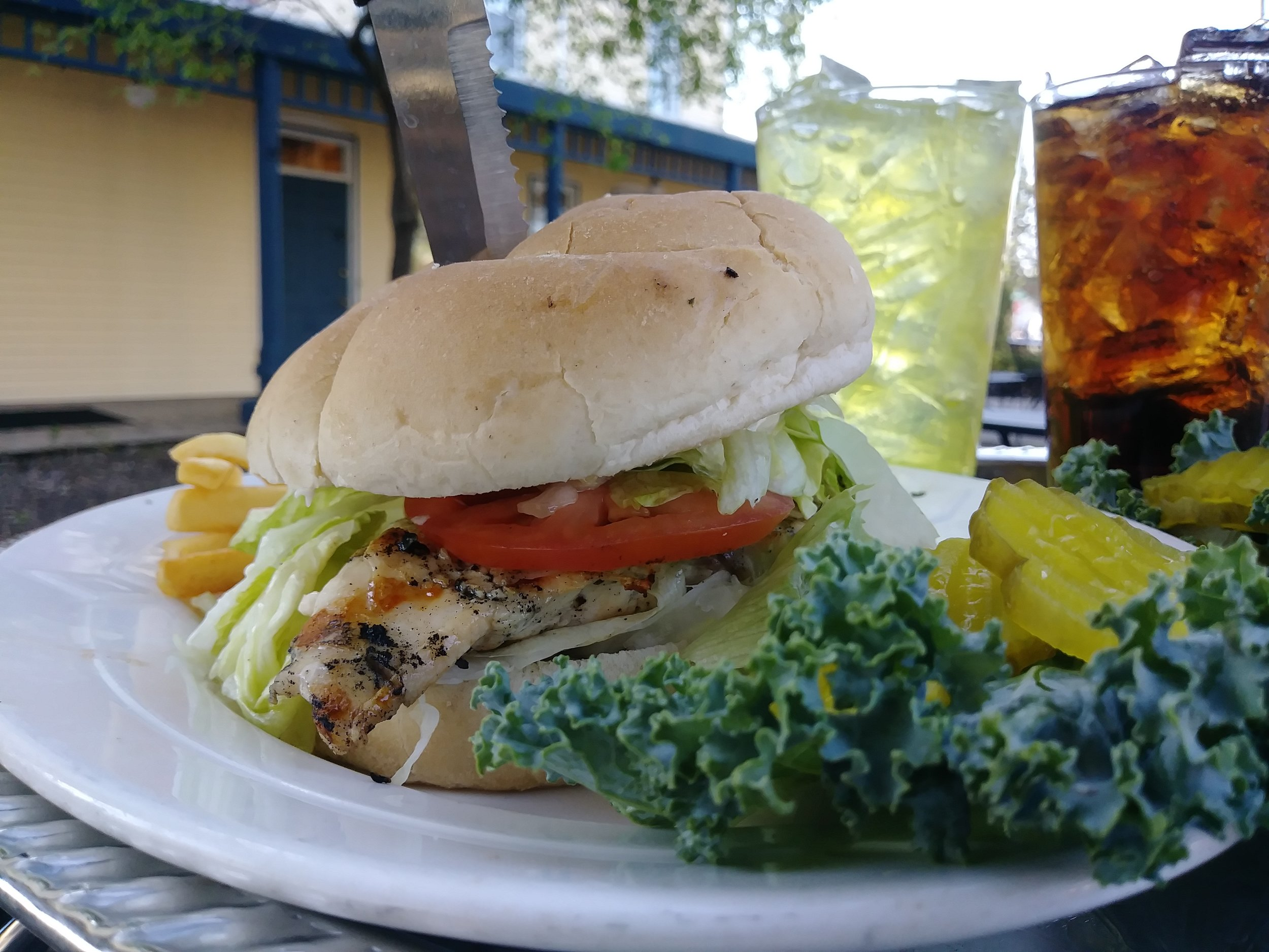 grilled chicken sandwich - 6 ounce grilled chicken breast broiled or deep fried; topped with lettuce, tomato, mayo, & served on a Kaiser Roll $10.99