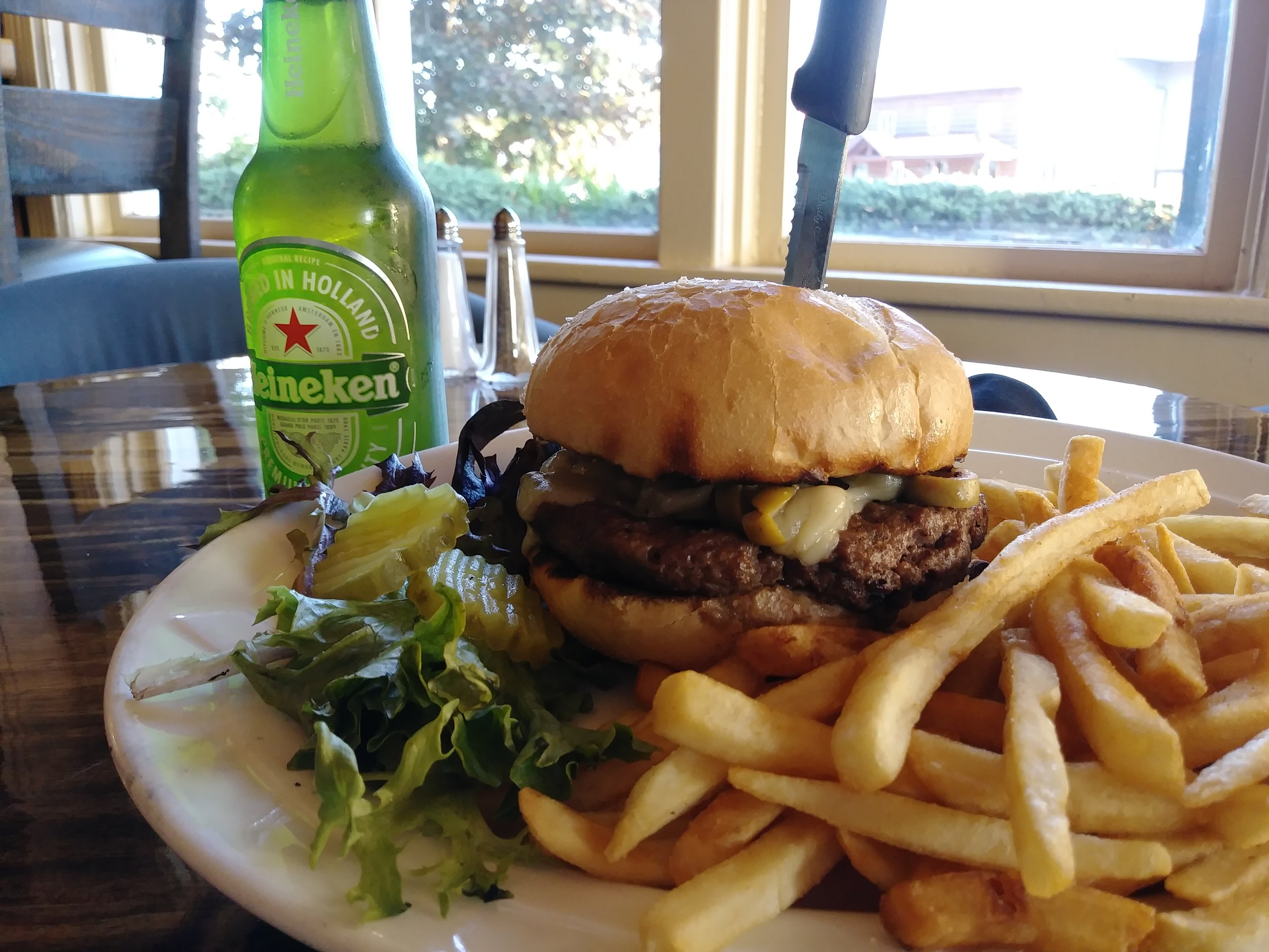 olive burger - For the olive lovers, this burger is loaded with a healthy portion of sautéed green olives and melted Swiss cheese $11.99