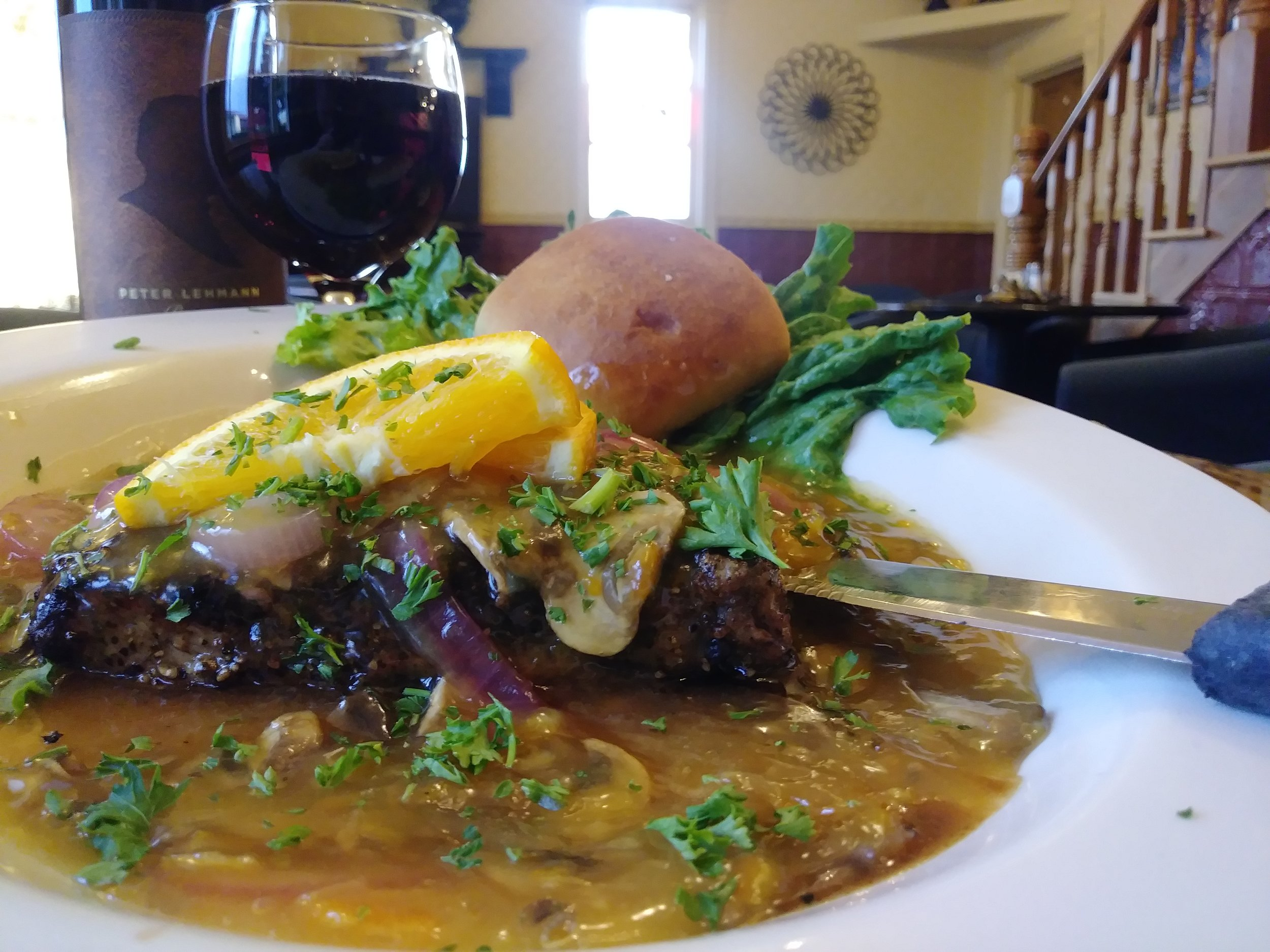 Peppercorn steak - Choice 8 ounce top sirloin, smothered in peppercorns, topped with red onions & mushrooms, then finished off with an orange marmalade sauce. A perfect combination of flavors for the spicier pallet $15.99