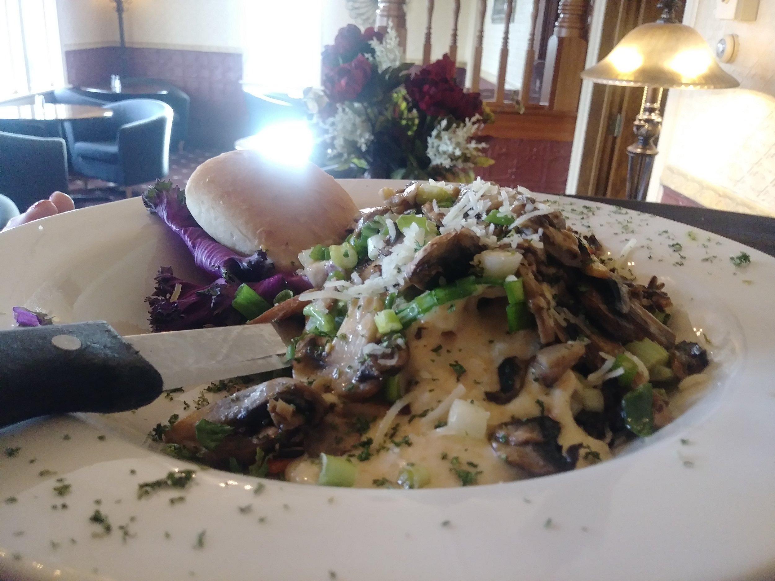 Northwoods chicken - A 6 ounce broiled chicken breast smothered with our own parmesan sauce and crowned with sautéed mushrooms & green onions, served over a rice pilaf $14.99