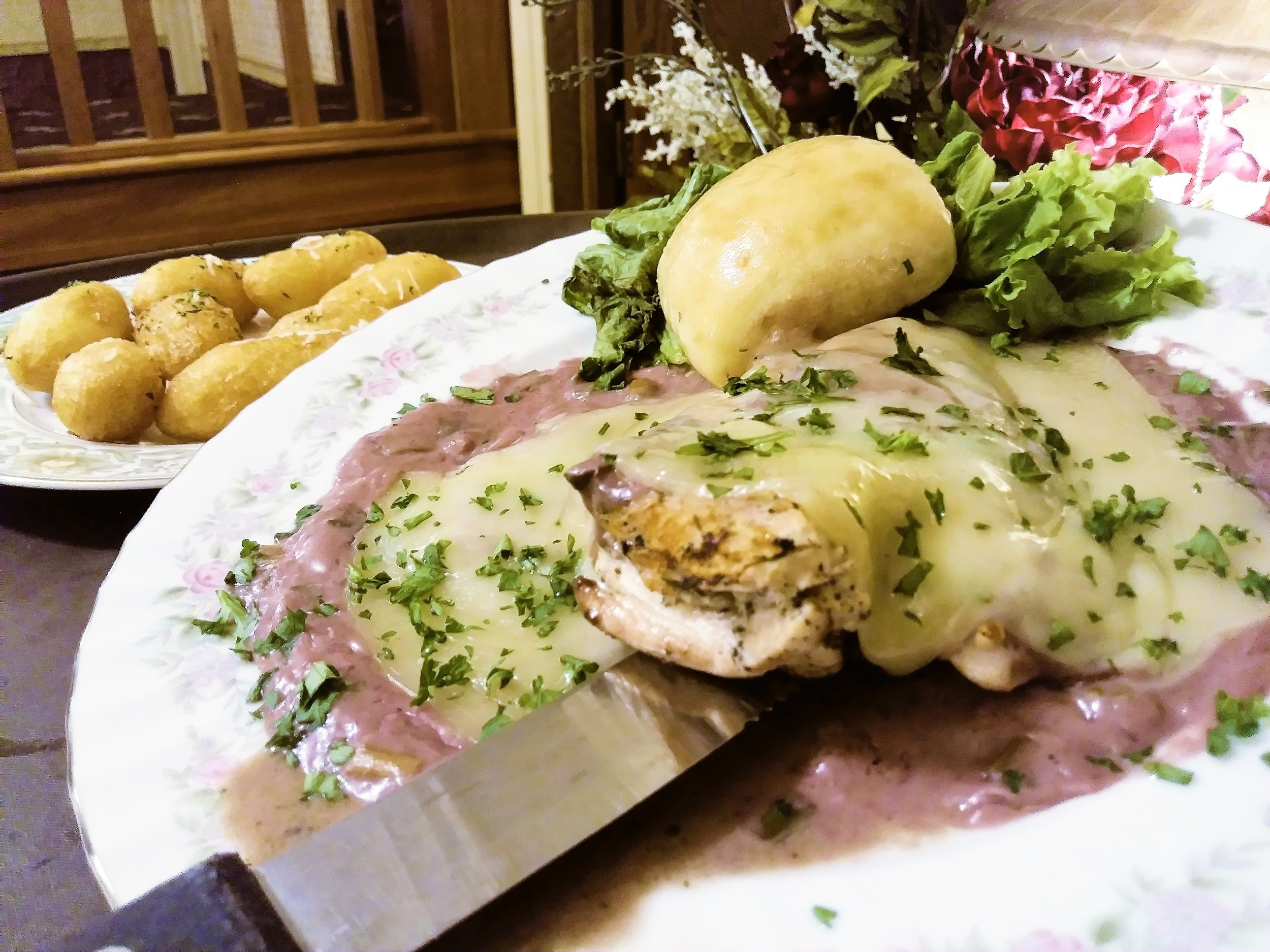 Mushroom & Swiss Chicken - A 6 ounce broiled chicken breast topped with sautéed mushrooms & onions in a red wine garlic cream sauce, and topped with melted swiss cheese $14.99