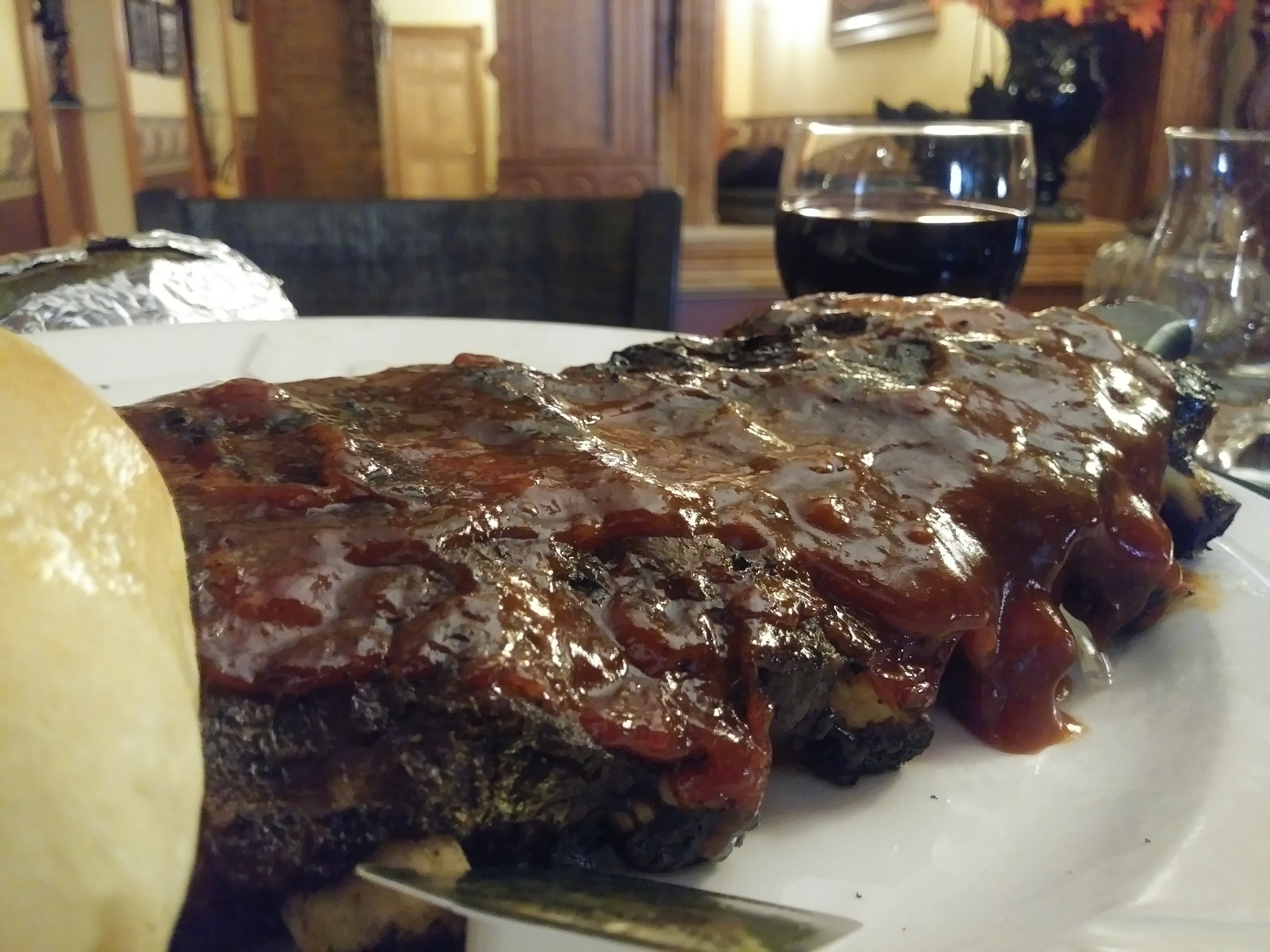 award winning bbq ribs - A generous portion of our award-winning pork back ribs complimented with our own sweet & tangy BBQ sauce recipe $15.99