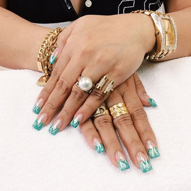 Aqua nails with airbrush designs to compliment our client's gold accessories 🏖 . . . . . . . . . . . . . . #nailart #nails #nailpolish #manicure #notd #nailstagram #ignails #acrylicnails #gelnails #nails2inspire #airbrushnails