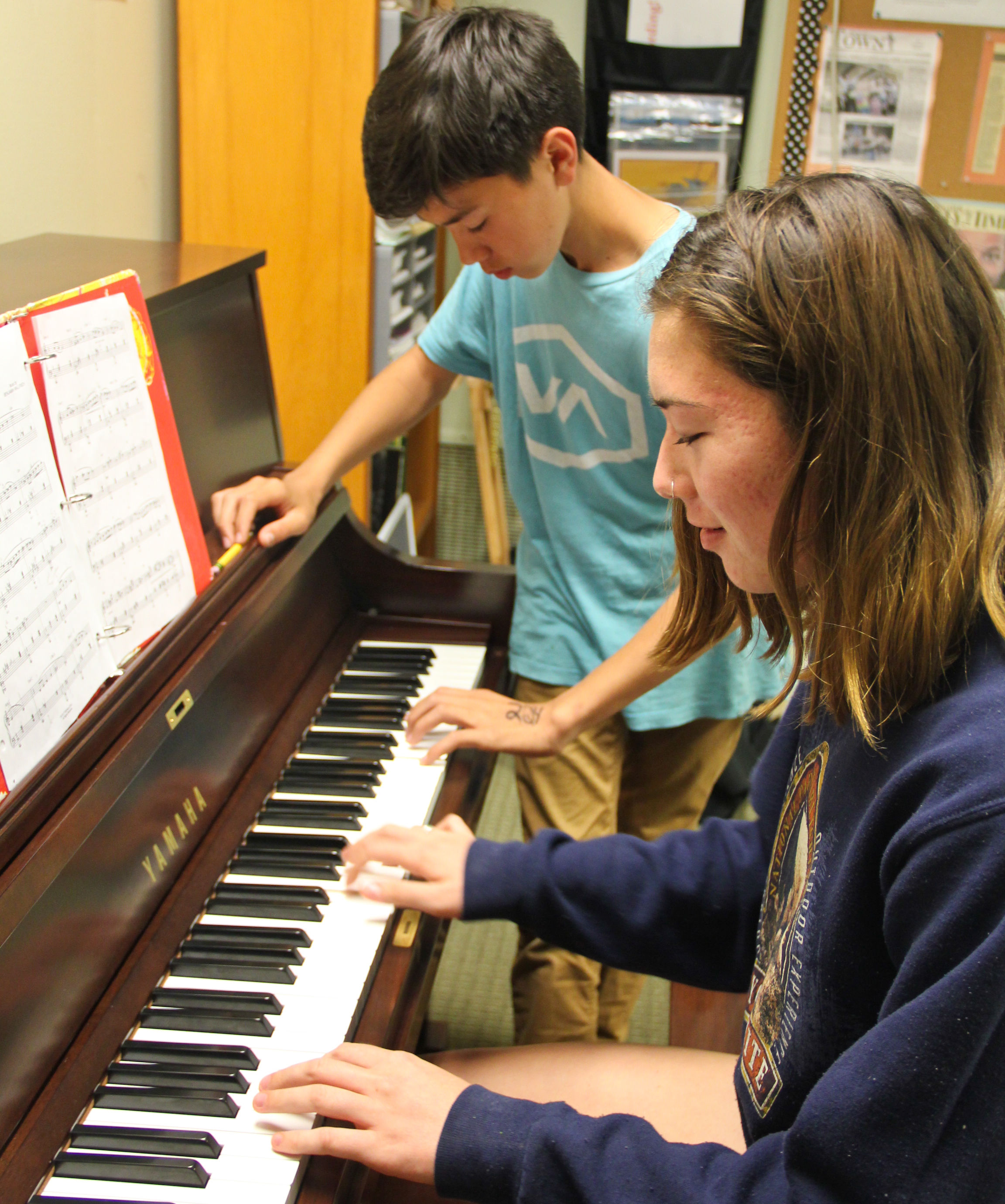 """Piano Classes for TeensTeens especially thrive in a group environment - it's 100% social! In addition to developing their technical and reading skills, the highlight of teen classes is the """"piano band"""" experience. Students enjoy regular opportunities to play their favorite pop tunes in a lively setting and among their friends. Creative skills are also enhanced as students progress, encouraging students to improvise and even write their own music. This engaging program helps keeps teens in music lessons for far longer and guides them to become lifelong musicians. -"""