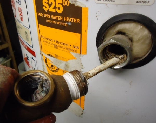 After this water heater had leaked, it was disassembled. it shows how much sediment ends up in and near the drain valve.