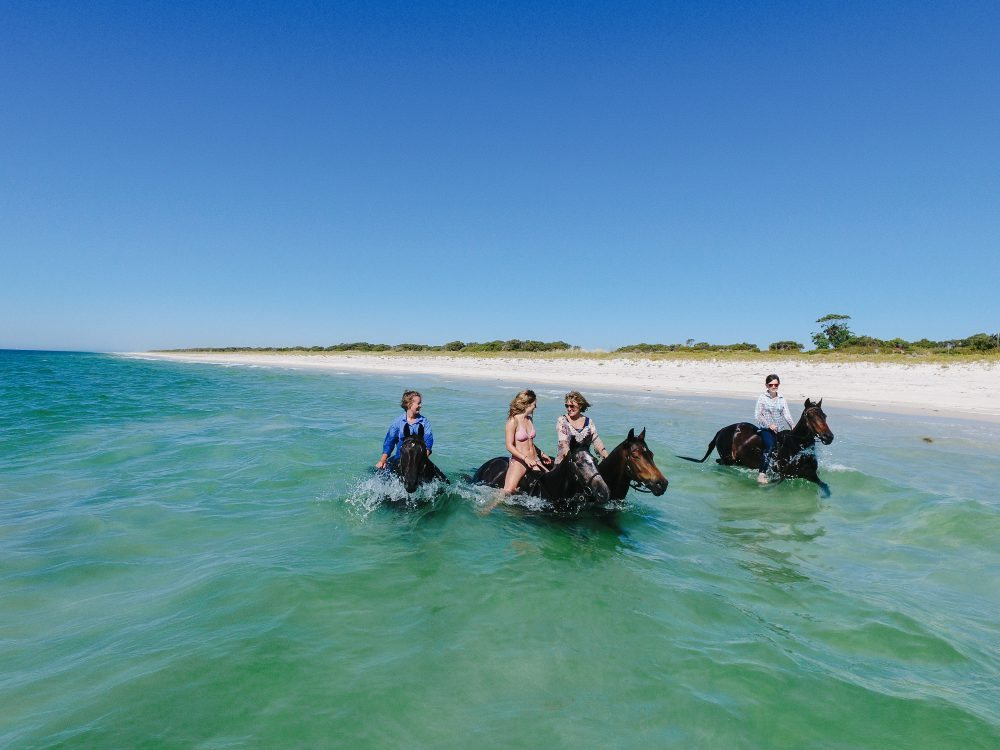 OH NO BIG DEAL, JUST RIDING HORSES IN THE CRYSTAL CLEAR OCEAN, AS ONE DOES  (Photo cred: http://www.globetrotting.com.au/galleries/the-margaret-river-ride/ )