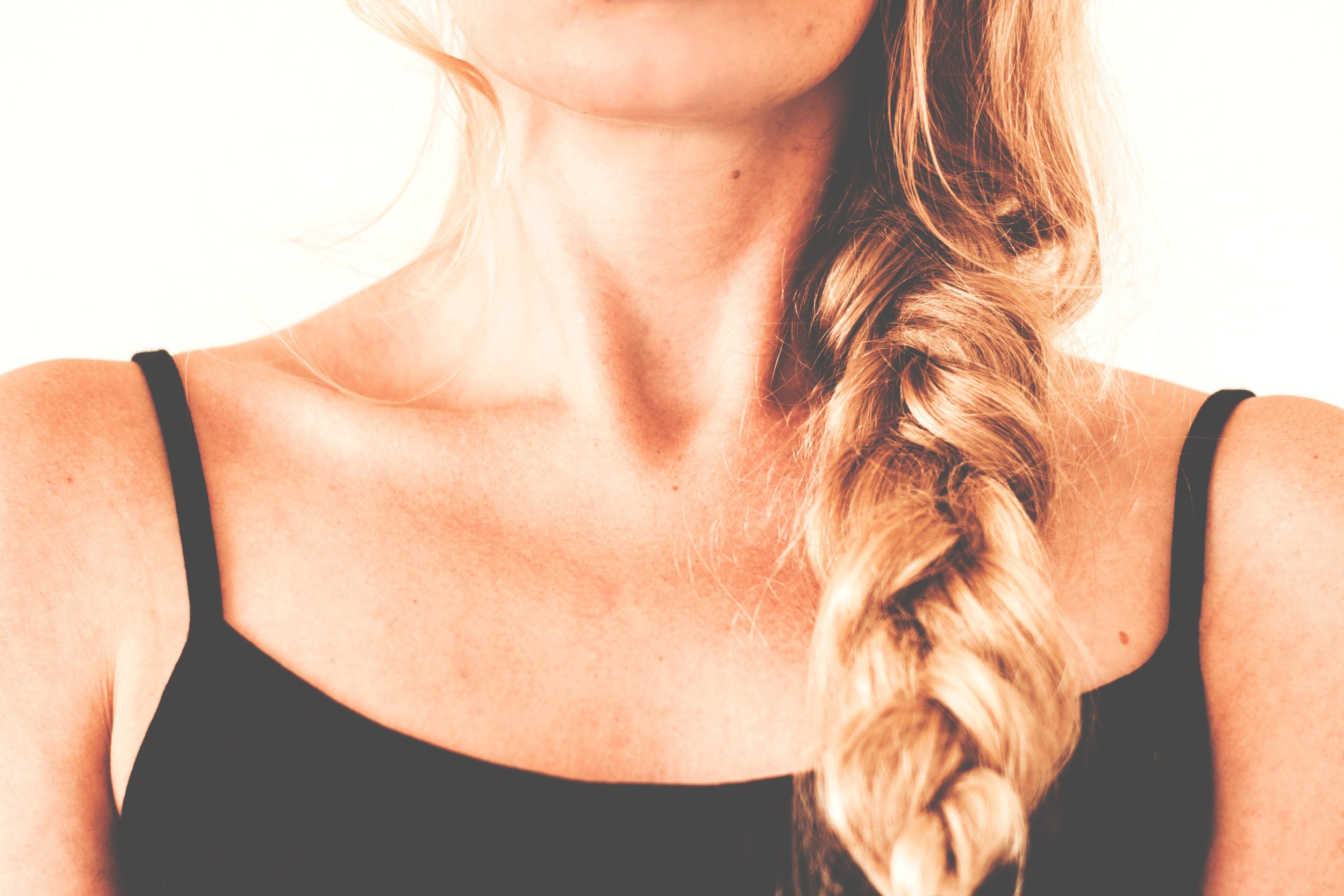 Messy Braid - If you have longer strands, consider switching up your date night look with a messy braid. Gather the length of your hair and pull it off to one side. Braid the hair that falls at the nape of your neck all the way down the remaining length of your locks. Secure the braid with a basic hair tie and then gently tug at the sides of the braid to give it a less polished, more romantic allure.