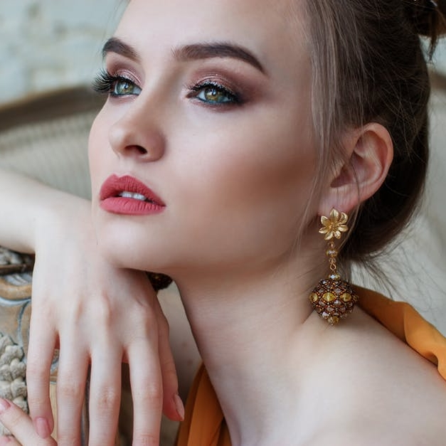 The Diva - Movie stars, models, singers- all of these personas scream diva. An elegant hairstyle is key to pulling off this dreamy look. This basic up-so looks glamorous and is as easy as putting your hair in a high bun and pulling a few pieces forward.