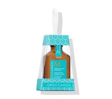 Moroccan Oil Treatment Holiday Ornament - Created in Israel, this highly renowned Moroccan Oil treatment aids in decreasing drying time, preventing tangles and restoring shine to all hair types. Packaged in a one-of-a-kind snowflake print box, all this ornament needs is a bow and it is pretty enough for giving.