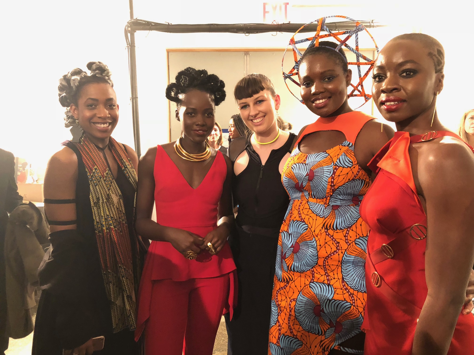 Tolu (left)and her Black Panther dress (second from right)