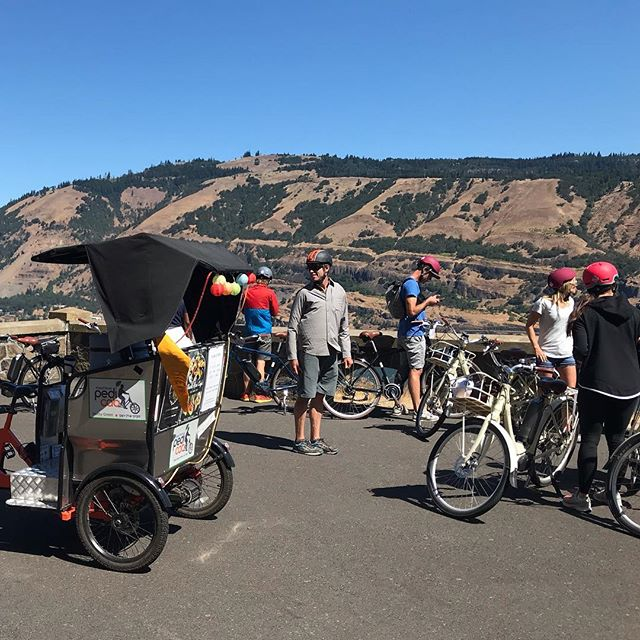 Hood River Pedicab and Sol Rides had our first collaboration this week, and we rolled very well together I must say.  Charlie Crocker is a master guide in every sense, sharing his passion for place and people, both present and past, with ease and grace. I sure learned plenty watching him in action. We had a work group from the Nike Beaverton campus out for the day to explore the Gorge and a selection of its wine offerings around the Mosier area.  The Twin Tunnels Trail conveyed us from Hood River in epic, scenic style. Kelly of Garnier Vineyards hosted us for the first tasting and we took lunch on their lovely deck. Across the highway we followed our noses to Idiot's Grace. Trevor took over tour duties here while walking the group through fascinating wine tasting talk, wandering right through the vineyard. The crew, including my rider John with his broken hand, were thoroughly content on the electric-assist cruise back to their cars. Can't wait to move in the pack again soon! @sol_rides @garniervineyards @idiotsgracewines . . . . . #sol_rides #garniervineyards #idiotsgracewines #mosier #columbiariver #columbiarivergorge #traveloregon #pedicab #pedicablife #pedicabs #pedicabdriver #pedicab4life #pedicabvibes #pedicabride #greenliving #radpowerbikes #ssupportlocalbusiness #gorgeowned #localbusiness #peditaxi #peddleassit #visithoodriver #hoodgorge #pnwlife #pnwonderland #columbiagorgous #mthoodterritory #pnwdiscovered #pnwonderland #columbiagorgous #mthoodterritory #pnwdiscovered