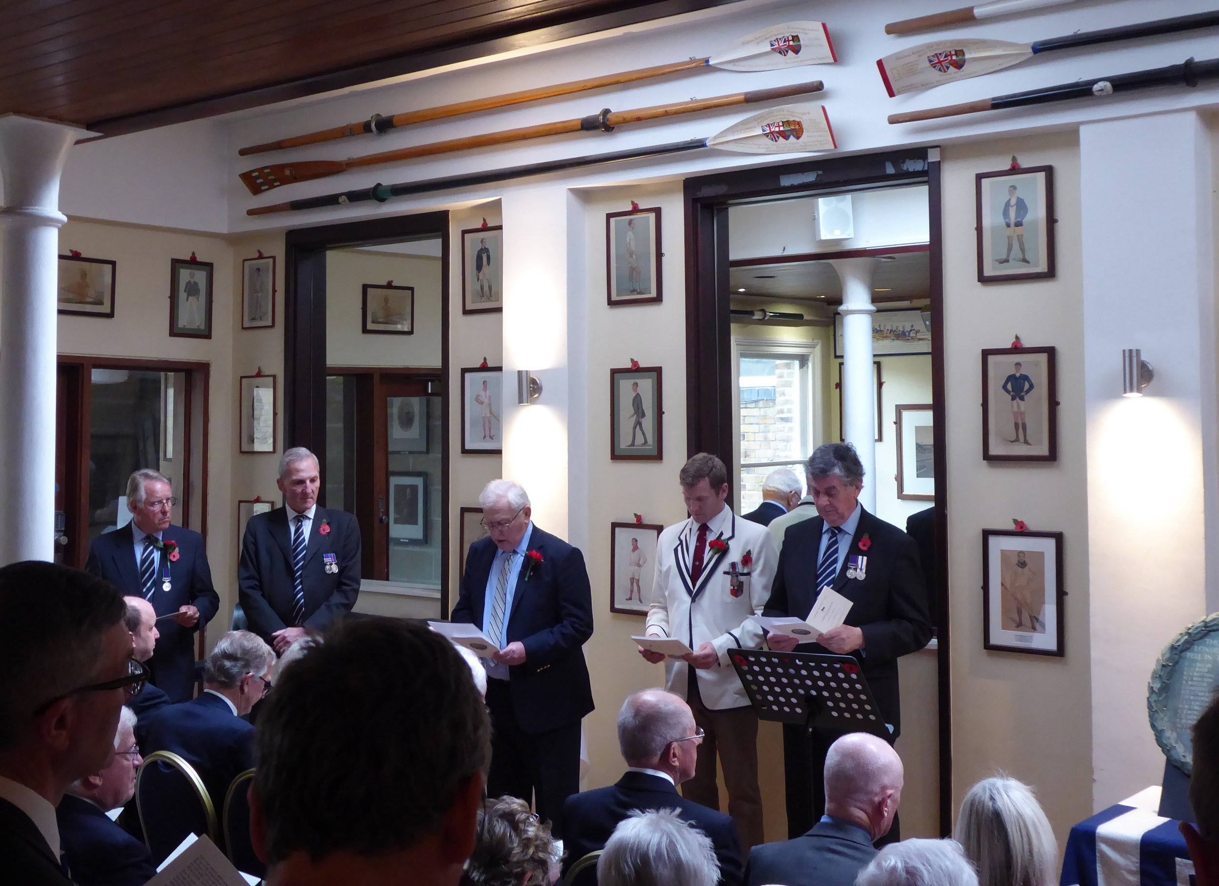Readers of the names of the 50 fallen (L to R) - Robin Cameron Cooper; Alan Foster; Peter Fraser; Tim Grant (Captain); Iain Reid. The re-dedicated war memorial tablet is on the right.