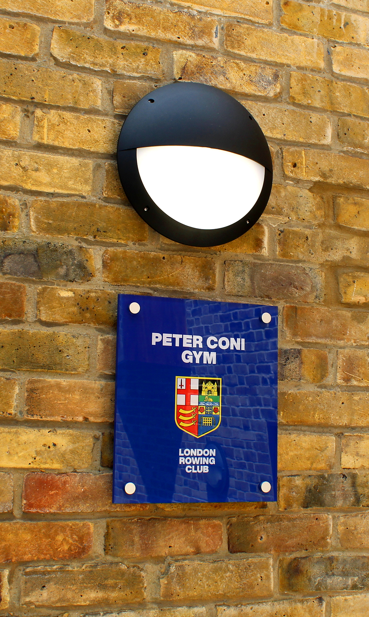 The_Peter_Coni_Gym_Entrance_Plaque_by_Bob_Silver_2019.jpg