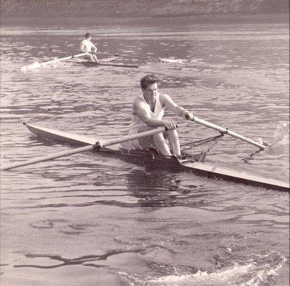 John Russell, foreground, competing in the Wingfield Sculls in 1959 in London colours. He overhauled the leader above Barnes Railway Bridge to win the race. Note the impressive puddle!