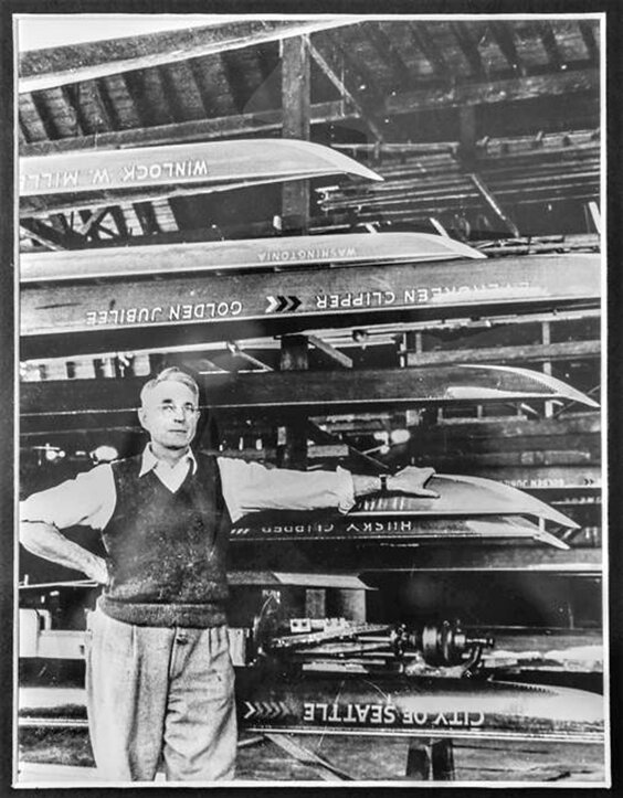 George Pocock with a collection of his shells, including the 1936 Olympic eight 'Husky Clipper'.