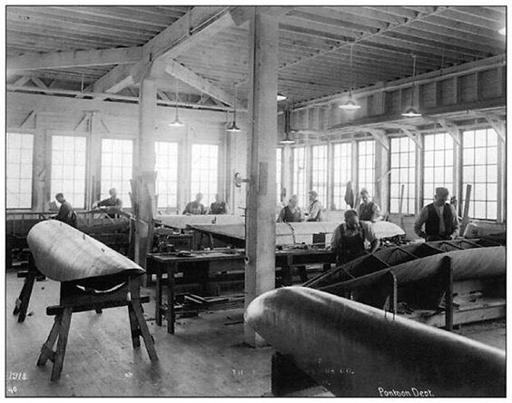 Having seen their racing shells, William Boeing personally recruited the Pocock Brothers to build seaplane floats from 1917 until 1922. Richard Pocock is at the far right. George is directly behind him, near the window.