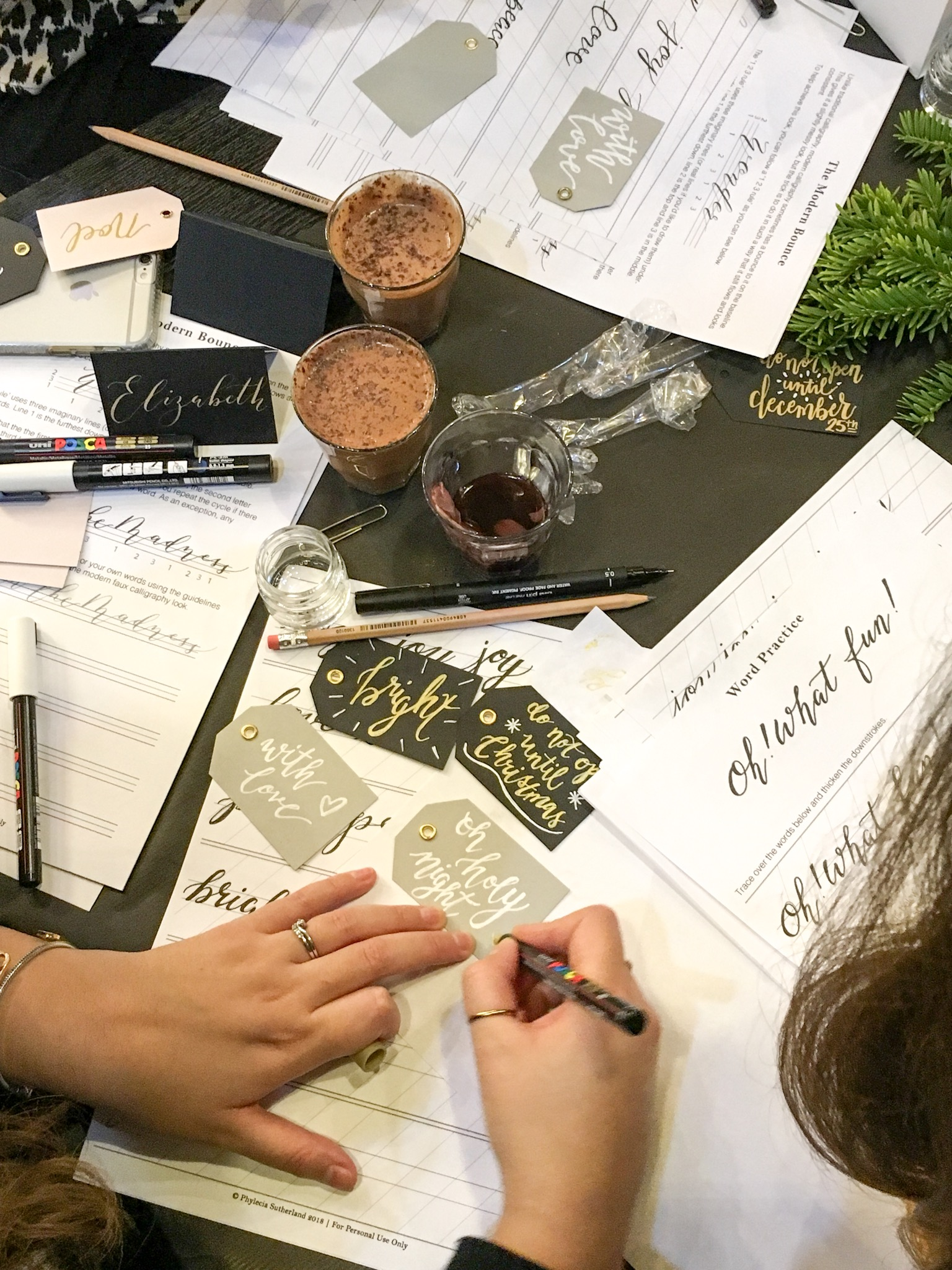Hand lettered Christmas gift tags during my faux calligraphy class in Leeds