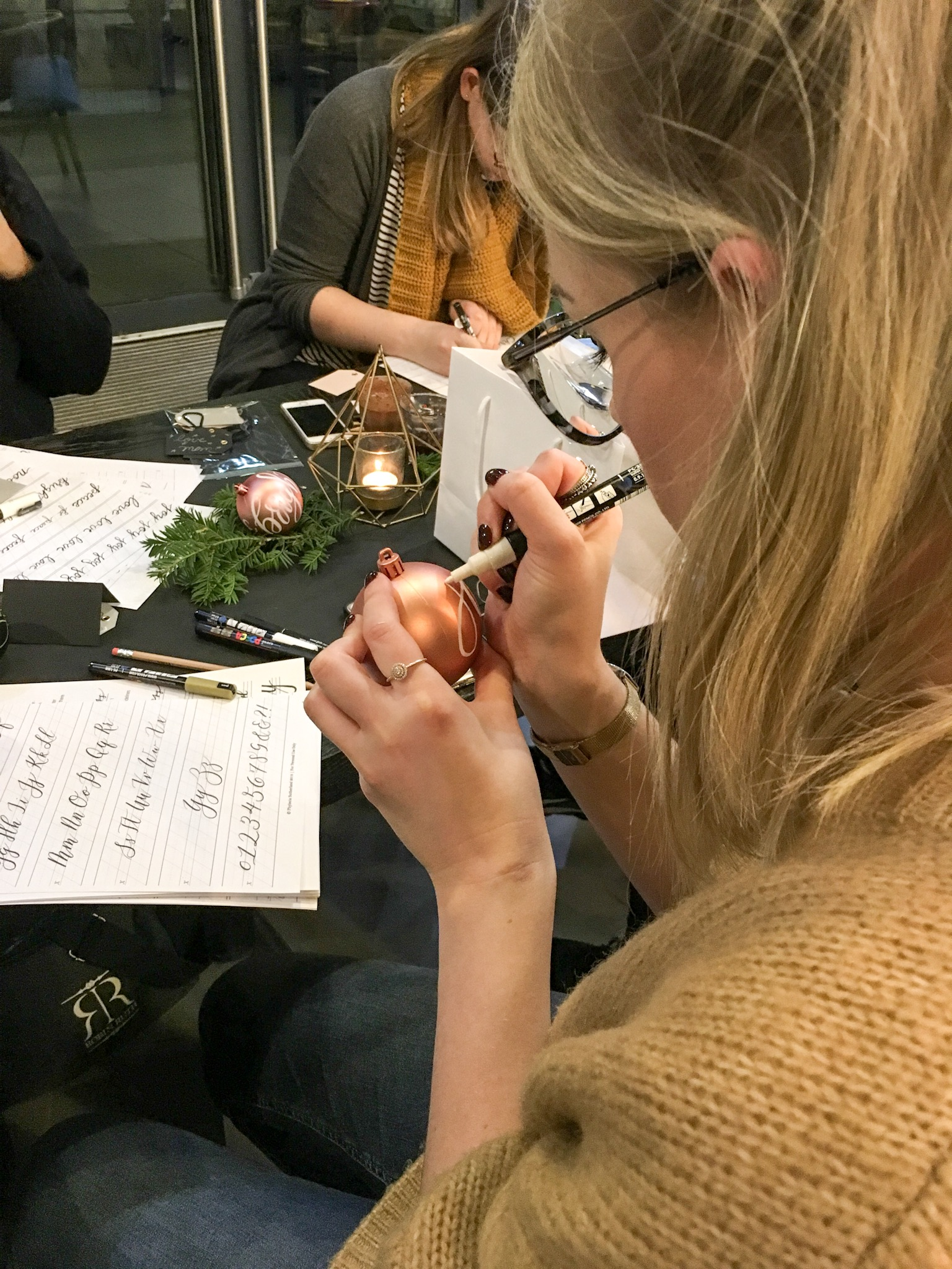 Christmas faux calligraphy on baubles during my hand lettering workshop in Leeds