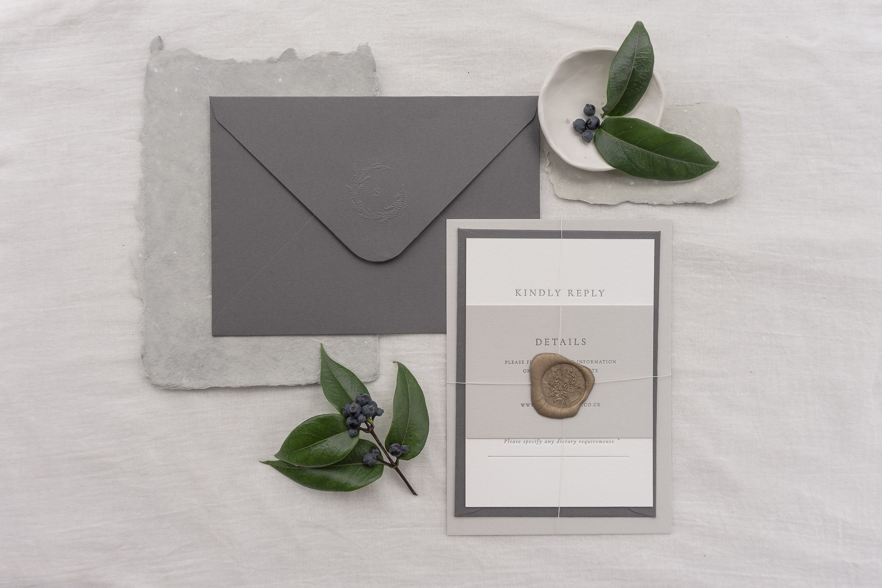 bound invitation and envelope wreath monogram wax seal modern class letterpress.jpg