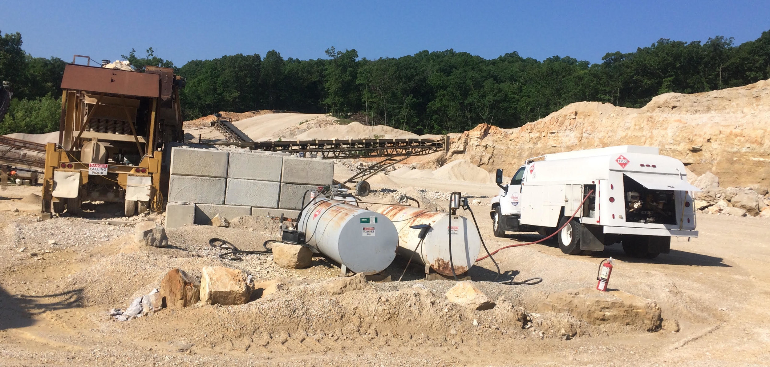 Servicing a temporary tank at a quarry.