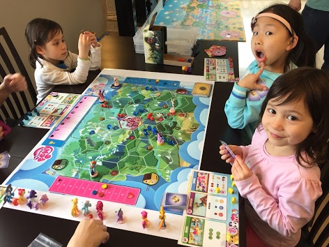 Vienna and her friends playing an early prototype of  My Little Scythe