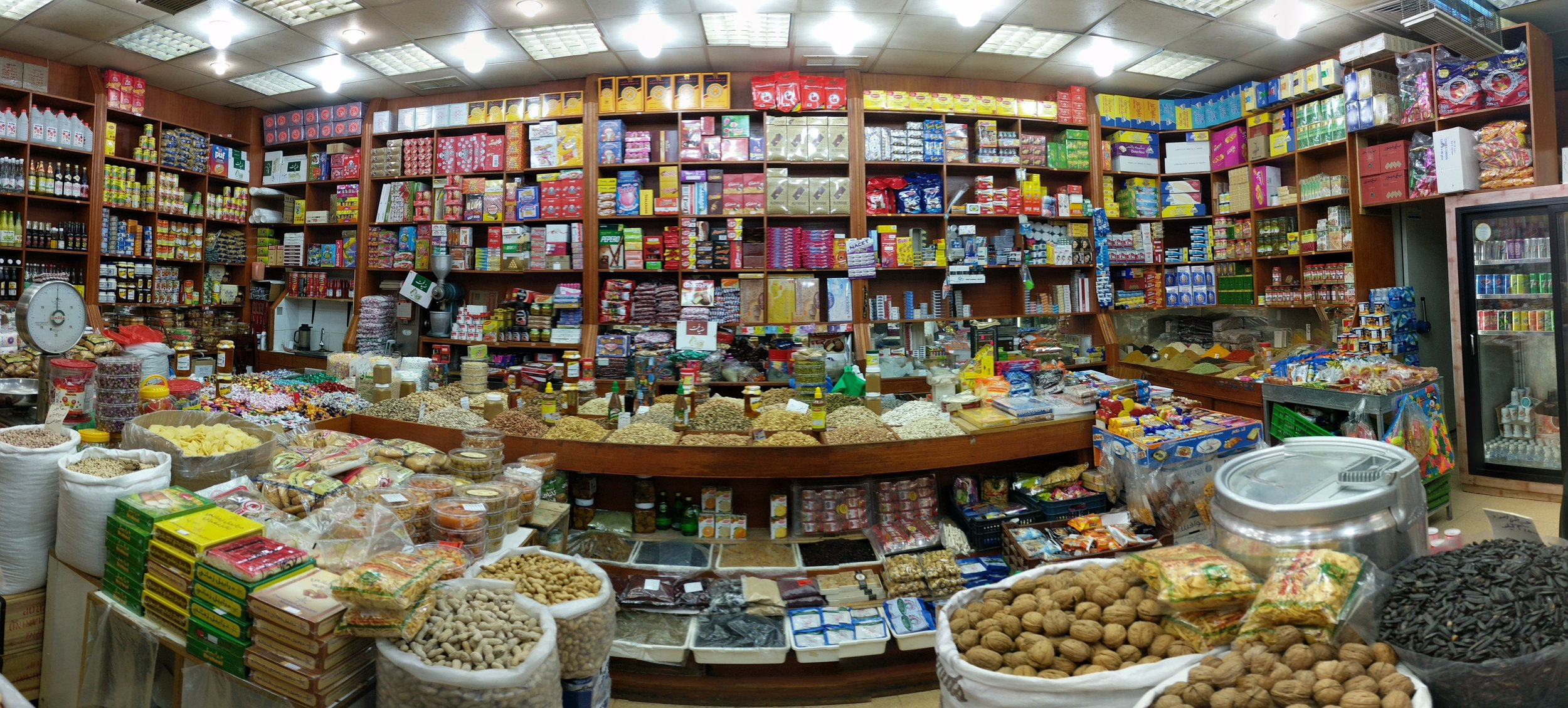 A typical souk stall selling nuts, dates, and packaged goods