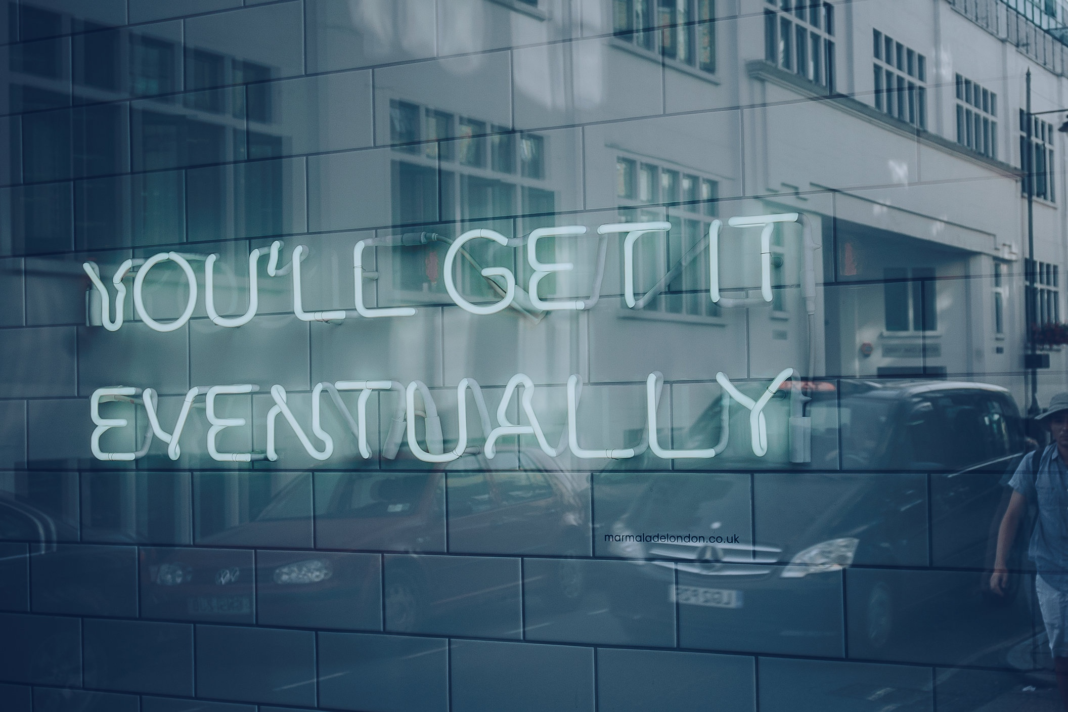 Neon sign that reads 'you'll get it eventually' reflecting how freelancers wait a long time to get paid by their clients