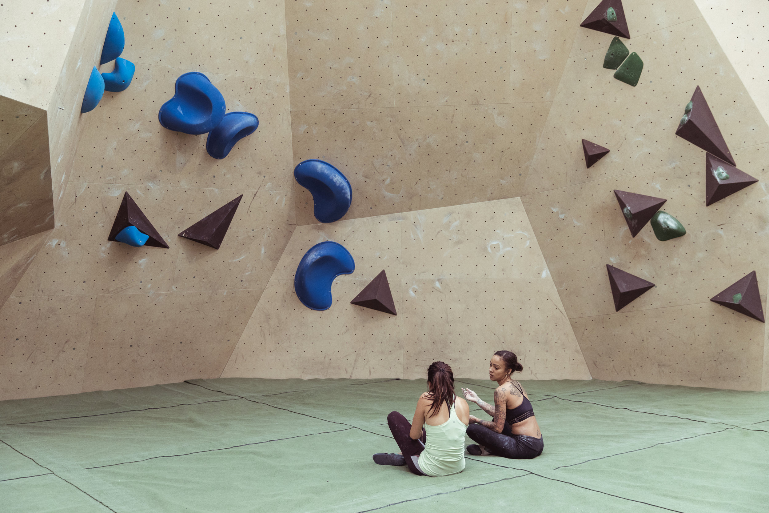 Joanne Chui and Carmen discussing the in's and out's of the moves to come. Photographer: Andy Donohoe, Climber: Joanne and Carmen, Yonder Competition Wall problem No.15 and No.11, Set 14.08.19