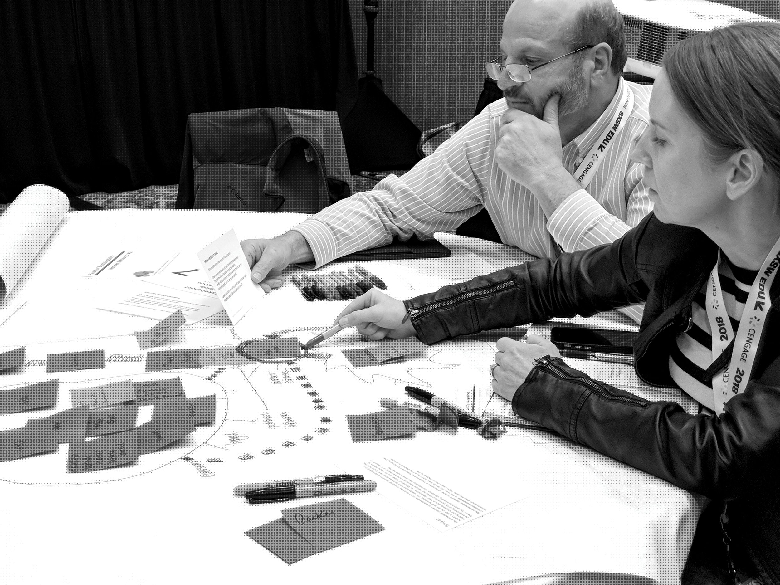 A team of two workshop participants thoughtfully consider the arrangement of their stakeholder map.